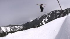 Action Sports: Skier Hitting Jump Doing a Switch Back Flip Stock Footage