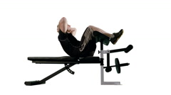 LS Man Doing Stomach Crunches on Exercise Bench with White Background 4K Stock Footage