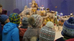 Kids Looking at Christmas Toys Carousels Houses Small Christmas Trees Factory - stock footage
