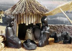 african nativity scene with baby jesus joseph and mary in a hut - stock photo