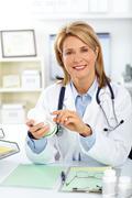 Mature doctor woman with pills. Stock Photos