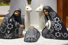 crib of South America with baby Jesus and black small ceramic statues - stock photo