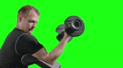 CU Man Doing Bicep Curls on Exercise Bench with Green Background 4K - stock footage