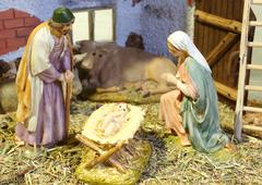 nativity scene with baby Jesus Mary and Joseph in the manger - stock photo