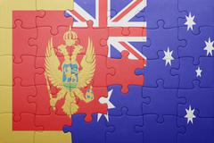 Puzzle with the national flag of montenegro and australia Stock Photos