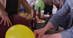 Hipster friends filling up helium balloons at party together and laughing Stock Footage