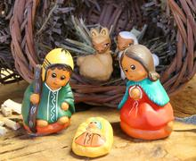 ethnic crib of Latin America with baby Jesus and the holy family - stock photo