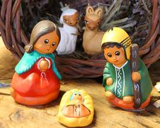ethnic crib of Latin America with baby Jesus and the his family in the stable - stock photo