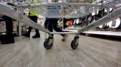 An accelerated footage of a supermarket trolley rolling Stock Footage
