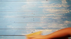 A process of polishing a wooden board with sandpaper to make it look older Stock Footage