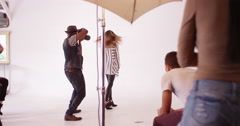 Team of professional stylists and assistants making adjustments to beautiful - stock footage