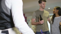 4K Couple shopping in a wine store use a mobile phone to make contact-less payme - stock footage