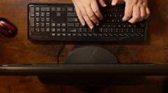 TOP VIEW - Business man executive typing on desktop computer. - stock footage