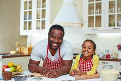 Cooking with father - stock photo