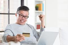 Winning prizes by making online payment - stock photo