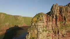 Drone shot of dramatic sea stacks at Duncansby Head near John O' Groats - stock footage