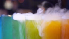 Colorful Cocktails with Ice Vapor on Bar Counter. Closeup Stock Footage
