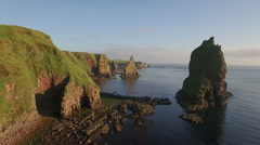 Drone shot of dramatic sea stacks at Duncansby Head near John O' Groats Stock Footage