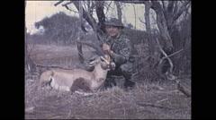 Vintage 16mm film, 1972, Kenya, hunter with dead impala - stock footage