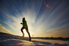 Running in snowdrift - stock photo