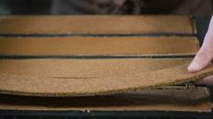 Pastry in his workshop preparing Chocolate Yule logs Stock Footage