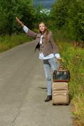 nice young woman with road suitcase voice - stock photo