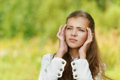 Head hurts young beautiful woman Stock Photos