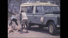 Vintage 16mm film, 1972, Kenya, hunters with dead impala - stock footage
