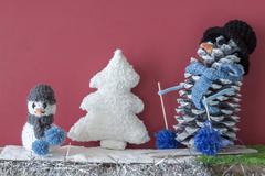 Xmas decorations crafts fireplace boy snowmen tree - stock photo