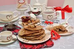 Bunch of delicious pancakes on Christmas crockery Stock Photos