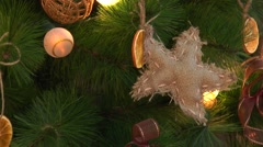 Toys on the Christmas tree lighted garland Stock Footage