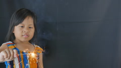 Cute girl playing by the fireplace with fireworks - stock footage