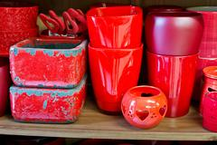 red flowerpots in the florist store - stock photo