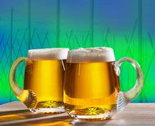 two beers with hop field - stock photo