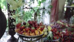 Fruits and berries on a buffet table Stock Footage