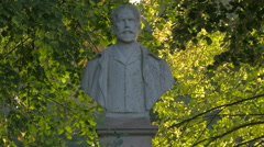 Bust statue of a man in Herastran Park, Bucharest Stock Footage