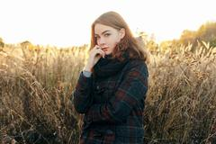 Young beautiful redhead woman faded meadow cold season outdoors Stock Photos