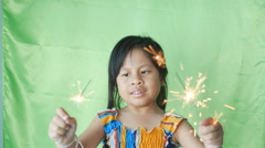 Girl playing by the fireplace with a New Year fireworks - stock footage