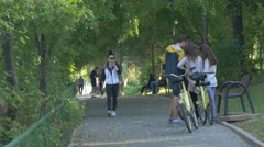 Running and relaxing on an alley in Herăstrău Park, Bucharest Stock Footage