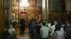 People and Clergy in Holy Trinity Jonah's Monastery Kiev Ukraine Dormition of a - stock footage