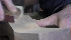 carpenter using sand paper - stock footage