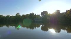 Sunlight reflecting in Lake Herăstrău, Bucharest Stock Footage