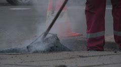 Repair holes in the road with hot asphalt. Stock Footage