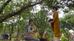 Statue People donate food to the Buddha Stock Footage