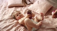 baby in a diaper on the bed - stock footage