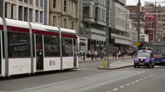 Tram going along Princess street in Edinburgh, Scotland Stock Footage