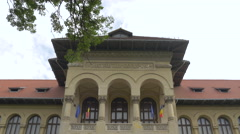 Stock Video Footage of The National Geology Museum's facade with arches in Bucharest