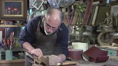 Carpenter using sand paper Stock Footage