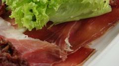 Hamon meat snack (jamon) in white plate (loop) Stock Footage