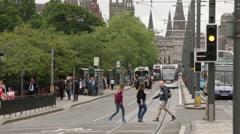 Tram going along Princess street in Edinburgh, Scotland Stock Footage